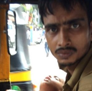 Mohammed Saeed, 26, was photographed driving around the street of Mumbai with his two-year-old son (Photo courtesy: twitter)